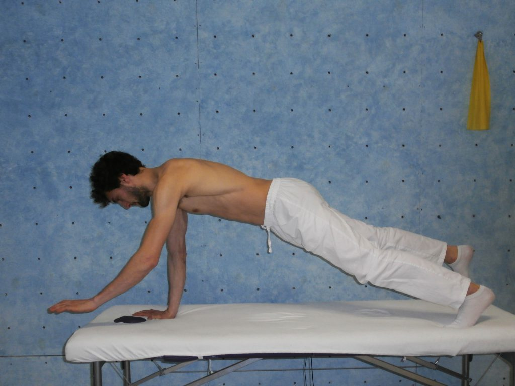 Reinforcement of the torso stabilizers. Vertical physiotherapy